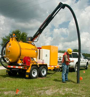 Worker using a Vac Trailer