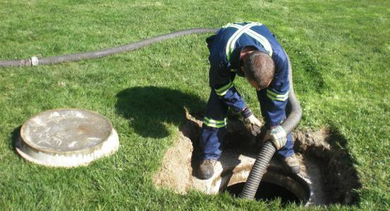 Septic Tank Cleaning Worker
